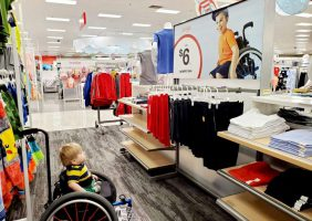 Image of Ollie in wheelchar looking at an inclusive add in Target. From Ollies World on FB