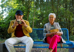Elderly People sitting on a bench